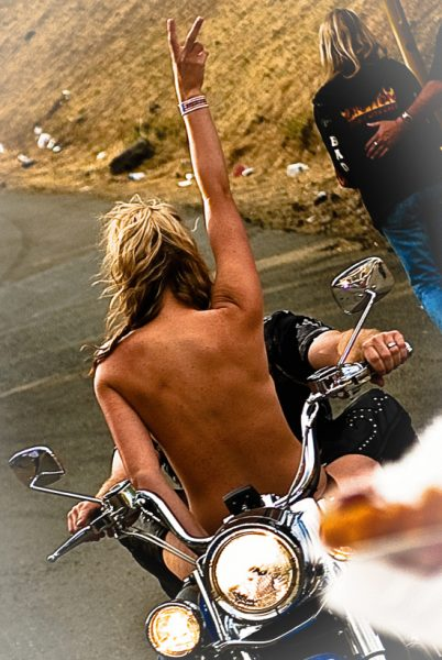 naked woman on a motorcycle peace sign