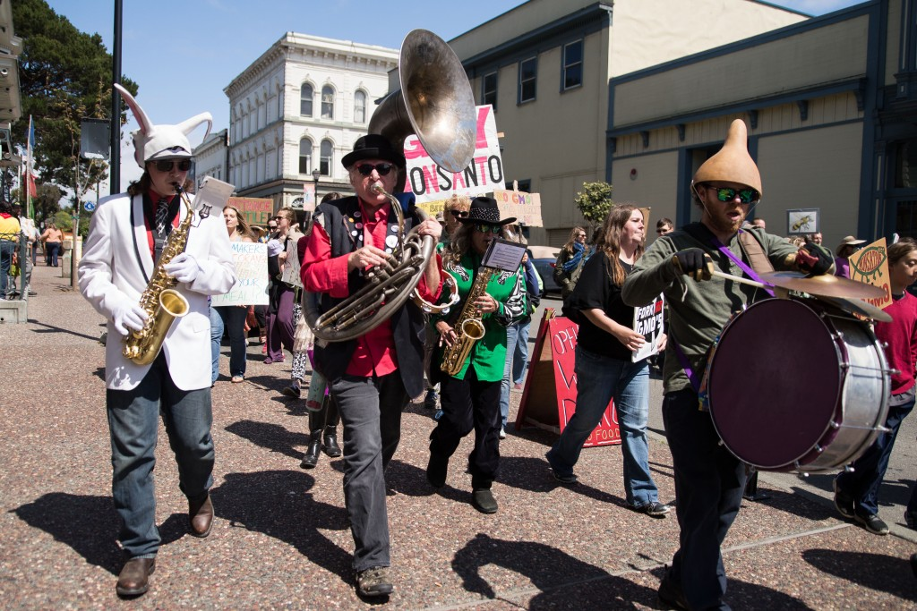 "The ""Parading Band"" marches with the anti-Monsanto group in Old Town."