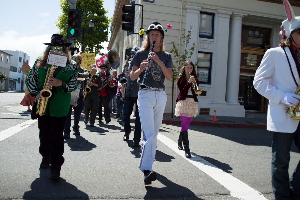 "The ""parading band"" walks down Fourth Street."