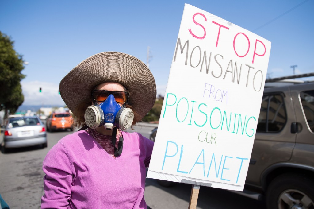 Tiffany Thurman, a 48-year-old ultrasonographer, stands outside the Humboldt County Courthouse with an anti-Monsanto sign.