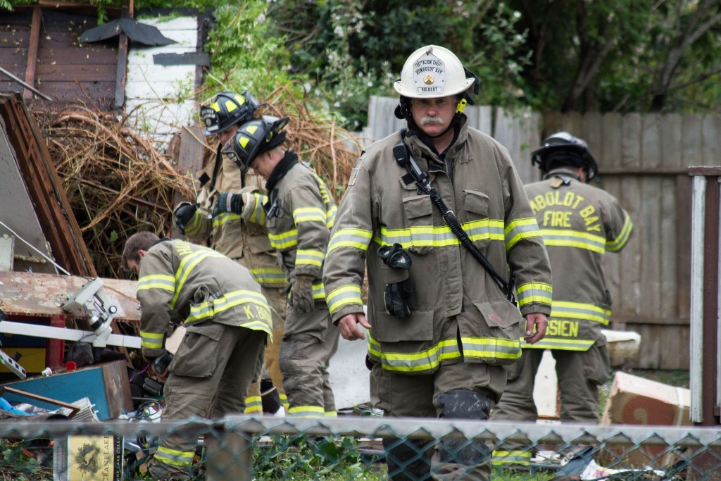 Humboldt Bay Fire battalion chief walks away from the damage from today's explosion.