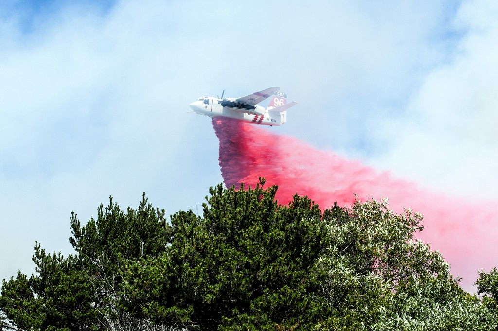 A CAL FIRE bomber based out of Rhonerville drops fire retardant on a fire near Manila Thursday afternoon.