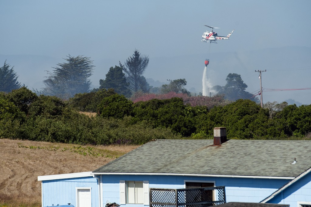 A CAL FIRE helicopter based out of Kneeland dropped water on a fire near Manila on Thursday afternoon.