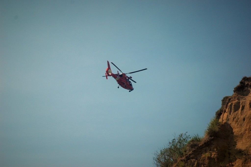Coast Guard helicopter helping to recover a body Saturday. {Photo provided by  link to the page and credit Marilyn and David Merte of the Humboldt County Facebook page]