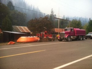 Structure protection in Forest Glen. [Photo from InciWeb]