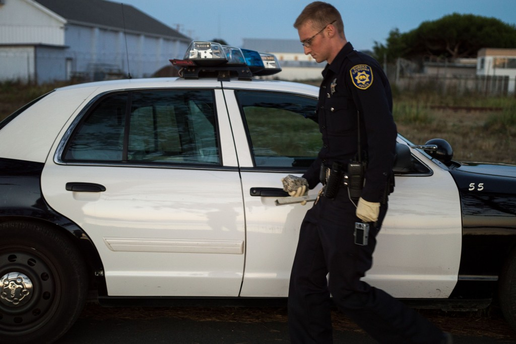 An officer carries the evidence to a police vehicle.