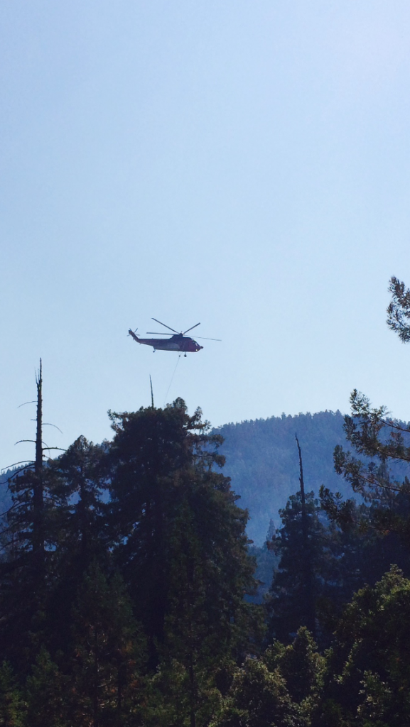 Helicopter fighting the fire. [Photo provided by a reader.]