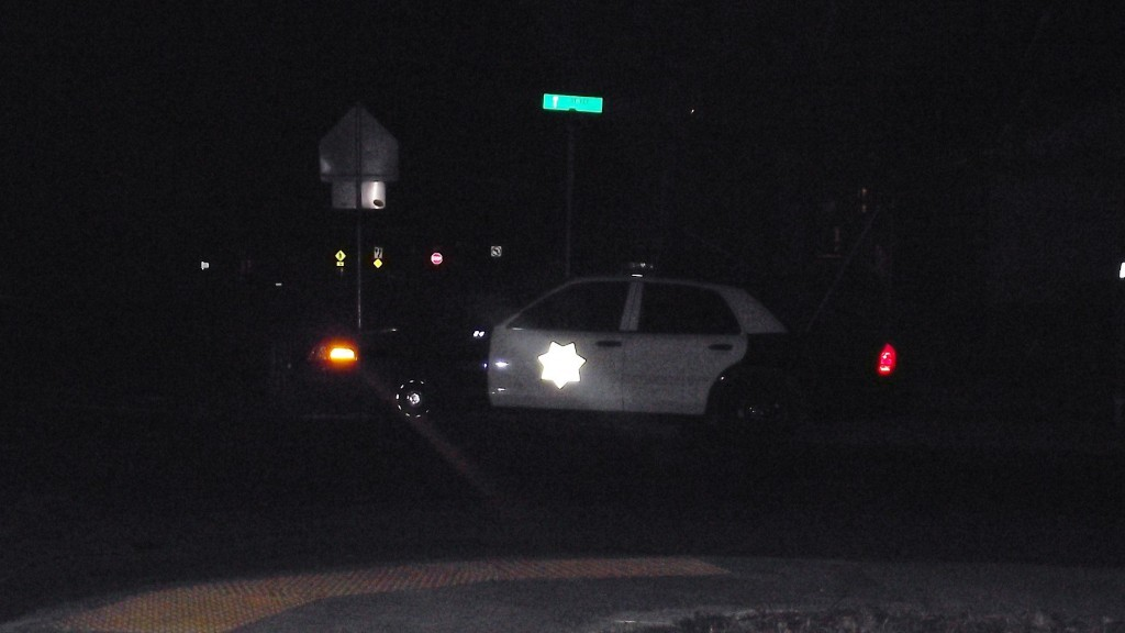 Eureka Police officers search for a suspect in a knife assault tonight. [Photo by Haida Bob]