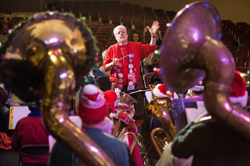 Fred Tempas directs the Tuba Christmas at the Eureka Theater on Saturday.