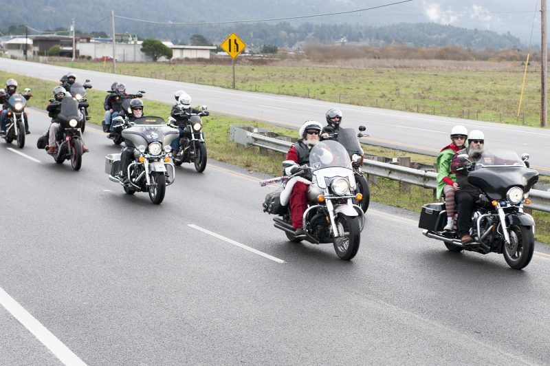 Ken Pinkham of the Christian Motorcycle Association, dressed as Santa, prepares to lead riders of the 40th United Bikers of the North Coast Humboldt Chapter toy run from the Arcata Plaza Sunday. Vince Campbell, President of the UBNC Humboldt Chapter rides to the right of Pinkham.