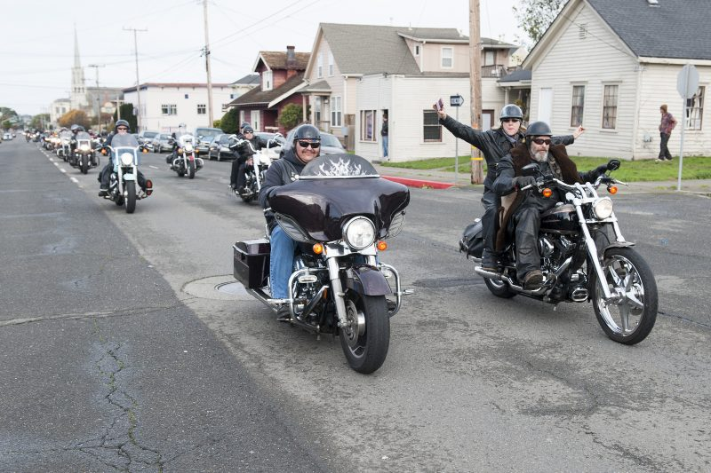 The long line of approximately two hundred motorcycles stretches as far as the eye can see down H Street in Eureka as riders head to the Moose Lodge.