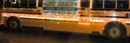 School bus with now hiring sign