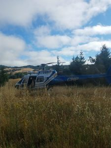 CHP helicopter landing beside rural road