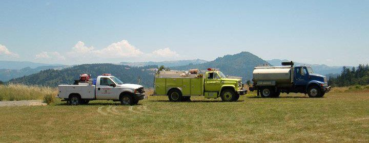 View from Salmon Creek school showing Bear Buttes in the background and SCVFD's vehicles in the middle ground.