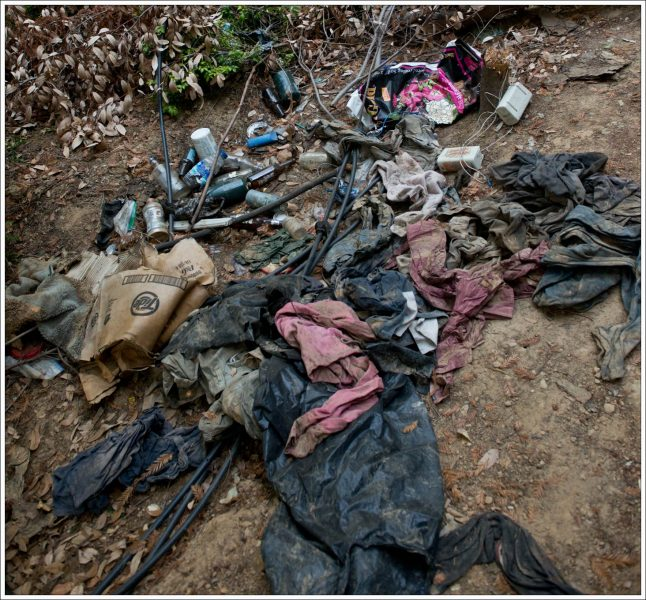 Discarded clothing found after fire at homeless encampment. photo by Kym Kemp