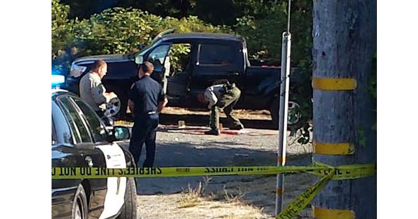 Law enforcement investigates a suspicious shooting. [Photo provided by a reader.]