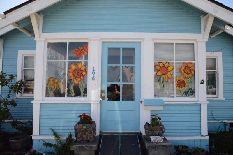 Blue house with flowers