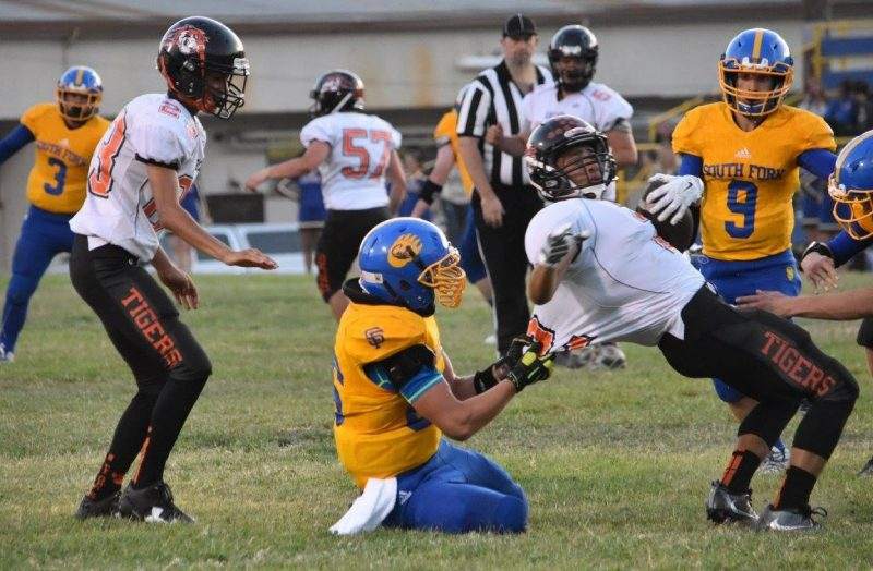 Junior defensive lineman Aaron Etherton pulls Arcata's star running back Demitri Patterson to the ground Friday night in Miranda.
