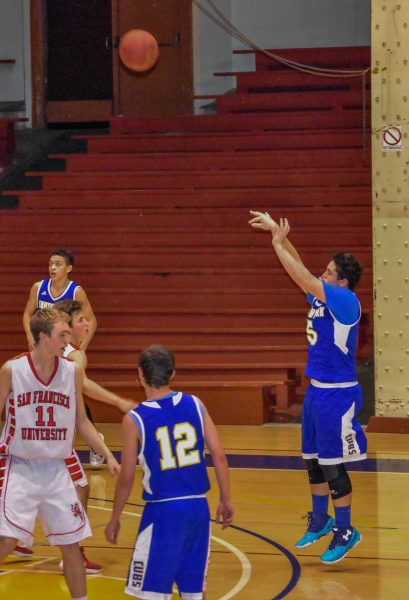 Playing small forward in last year's NCS game in San Francisco, Coffelt takes a three-point shot.