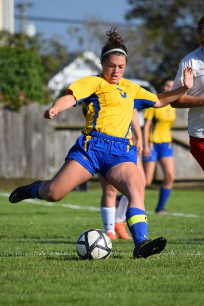 senior midfielder Victoria Van Meter prepares to send a pass to one of her forwards in Ferndale last Wednesday.