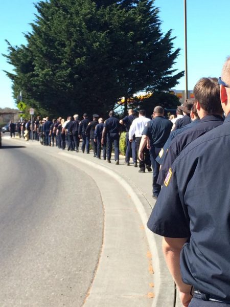 A procession of firefighters filed into the memorial service. [Photo by Deb Lake]
