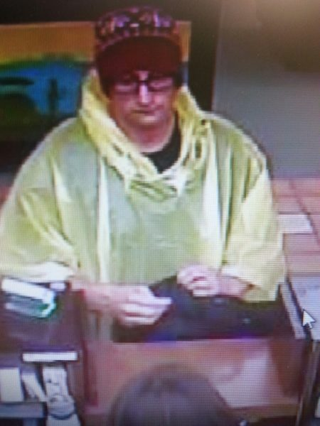 Bank robbery suspect in a rain poncho