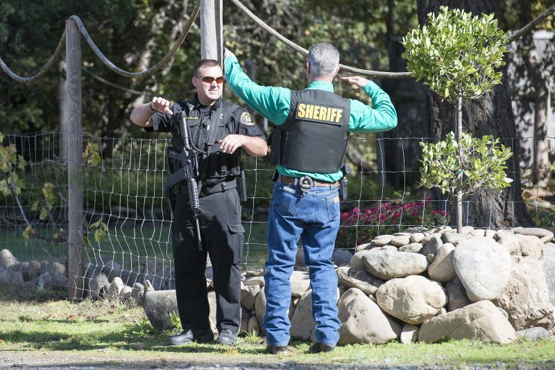 Sheriff Bruce Haney talks with a deputy near the scene.