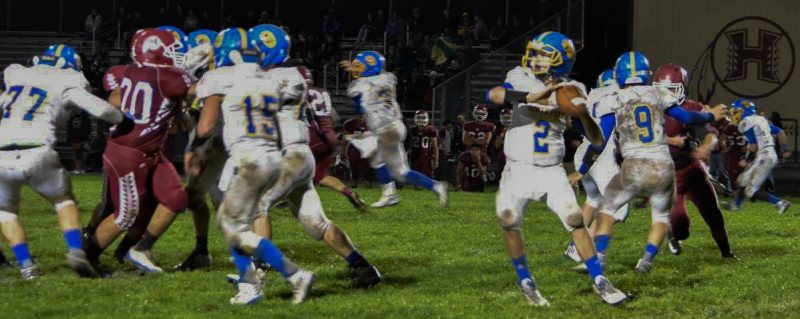 Quarterback CJ Van Meter, #2, prepares to pass the ball last Friday night in Hoopa [Photo by Janice Coffelt]