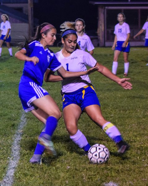 Senior midfielder Noelia Alatorre (right) battlers for the ball against Fortuna last Wednesday night in Miranda. [Photo by Suzanne Van Meter]