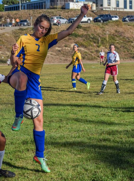 Junior striker Olivia Baffert wins the ball despite being tugged on by a Mendocino defender. Photo by Suzanne Van Meter