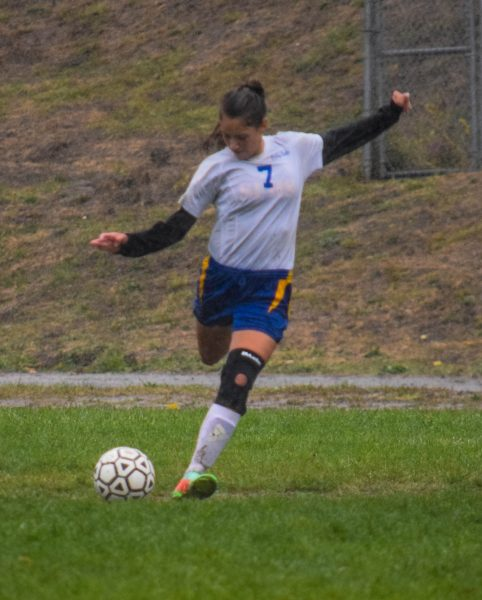 Junior striker shooting and scoring one of her three goals against St. Bernard's last Saturday in the steady downpour [Photo by Suzanne Van Meter]