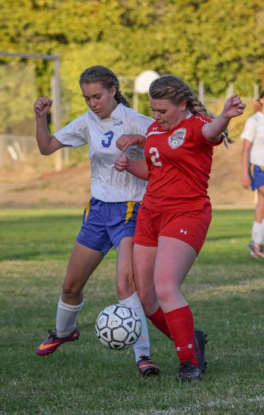 Senior Midfielder Raya Mahony wins the ball from her Ferndale opponent [Photo by Suzanne Van Meter]