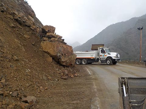 Caltrans dumptruck and big boulder