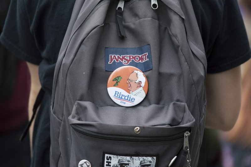 A student sports a Bernie Sanders pin on his backpack.