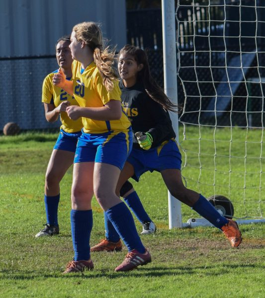 South Fork defends Crusader corner kick. Left to right: Fullbacks Stef Bautistaand Daphne Hobbs and Goalie Paloma Avilez [Photo by Suzanne Van Meter]