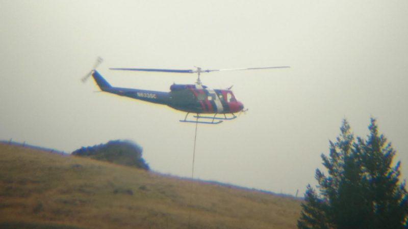 PG&E helicopter carrying poles