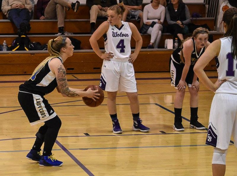 Senior Shondra Moser at the freethrow line with sophomore Haylie Mulder to the right. [Photo by Janice Coffelt]