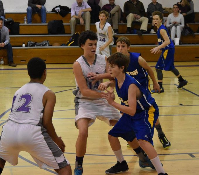 South Fpork JVs playing tough defense in Fort Bragg last Tuesday. Pictured are Derrick Baldwin, Ayden Gallagher behind him and Jayden Paine top right. Photo by Janice Coffelt