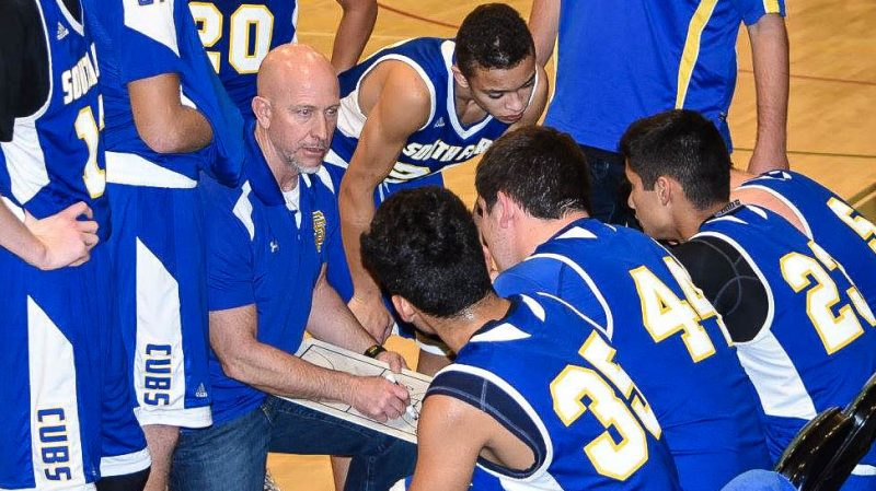New head coach Todd Vandenack talking to the team during a timeout last season [Photo by Janice Coffelt]
