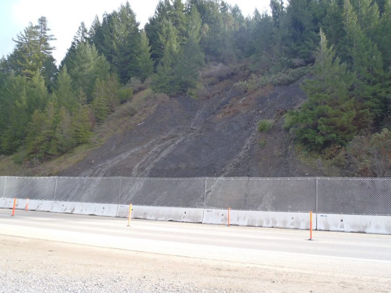 fence blocking debris from falling on 101
