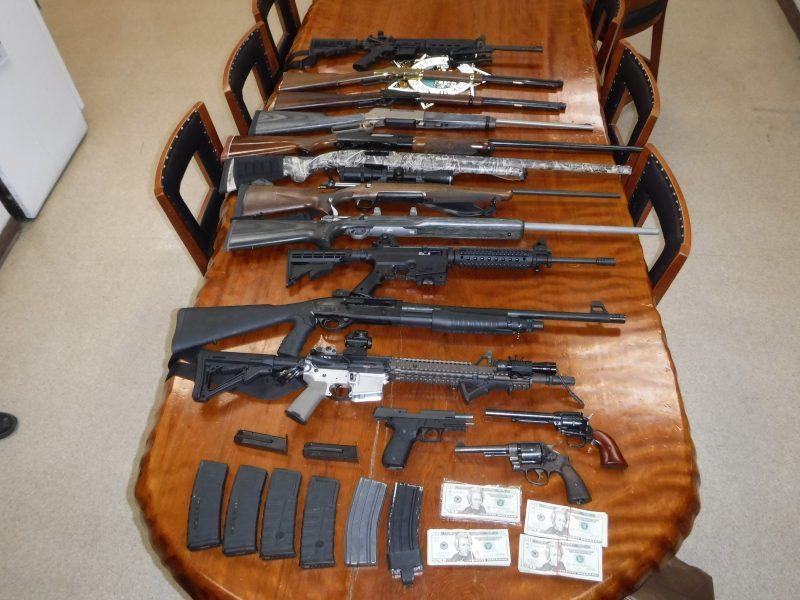 Firearms on a table, guns