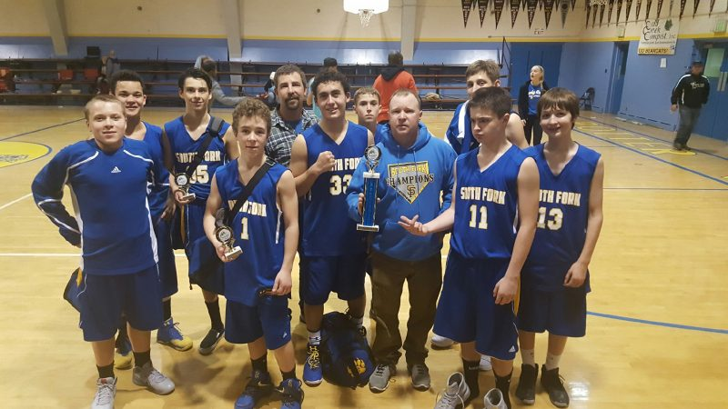 JV Boys with their 2nd Place trophy Saturday in Potter Valley. Coaches Kelly Paine (left) and Brett Van Meter (holding trophy) are also pictured. [Photo by Gina Paine]