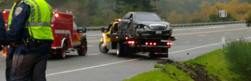 Car from crash being towed