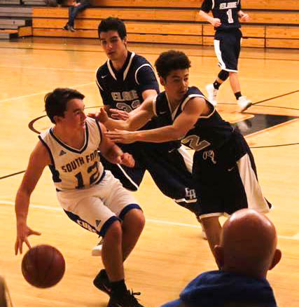 Ryder Pfau fights off a double team in Kelseyville [Photo by Crystal Salomon]