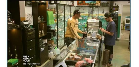 man purchasing item at trim shop