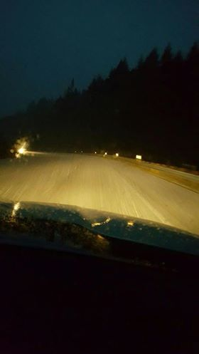 snow on road through front windshield