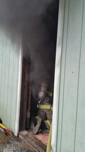 Fireman entering burning building.