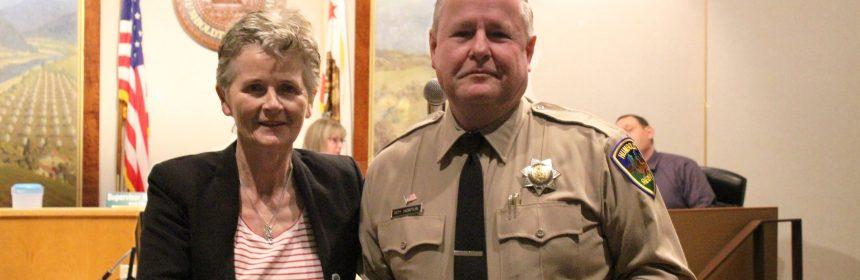 Supervisor Estelle Fennell congratulates Roy Horton on his retirement.