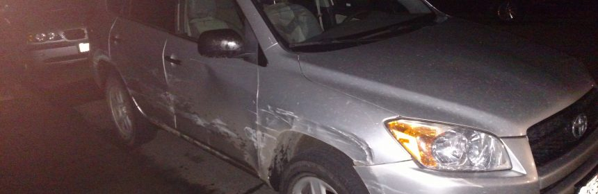 battered 2010 silver Toyota Rav4