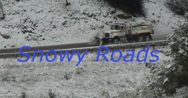 Caltrans dump truck plowing road